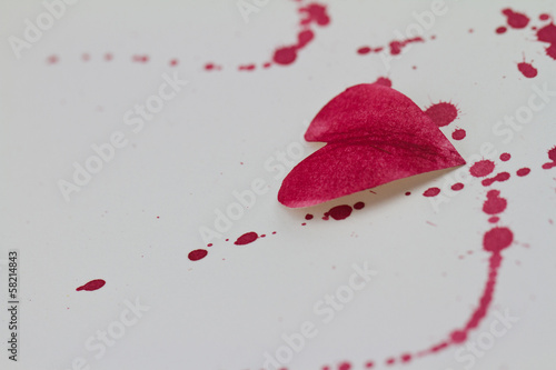 Paper heart and red splashes