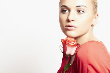 girl and flower. beautiful woman in red dress.isolate