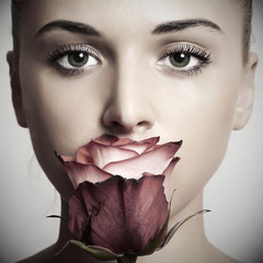beautiful blond woman with flower.girl and rose.skin care