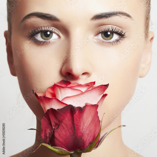 beautiful blond woman with flower.girl and rose