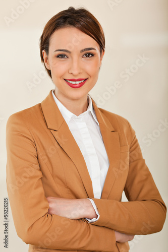 business woman smiling with  her arms crossed