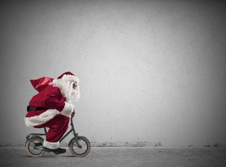 Fast Santa Claus on the bike