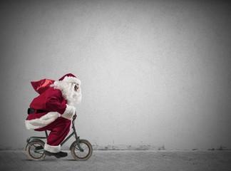 Fast Santa Claus on the bike