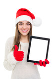 Beautiful young Santa girl showing tablet and thumb up