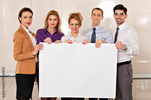 team of business people holding cardboard