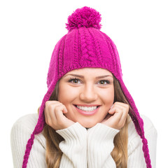 Beautiful teenage girl wearing magenta winter hat