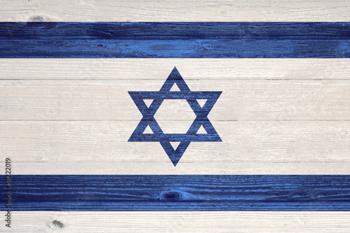 Israel Flag painted on old wood plank background.