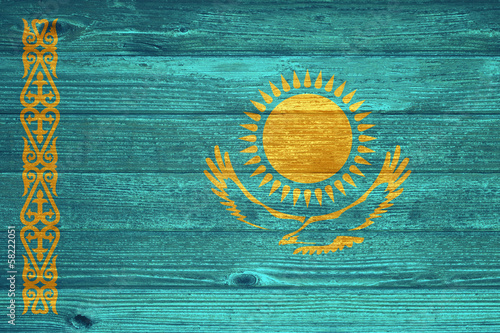 Kazakhstan Flag painted on old wood plank background.