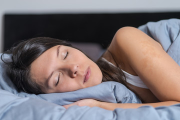 Attractive woman enjoying a peaceful sleep