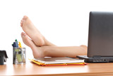 Woman resting at work with the feet over the office table