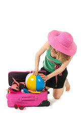 Packing the suitcase by a young woman