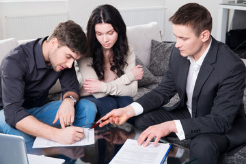 Agent advises the couple, signing documents