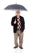 retired man holding umbrella