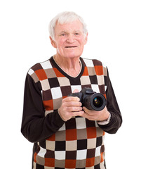 happy senior man holding a camera