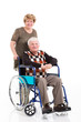 disabled old man sitting on wheelchair with caring wife