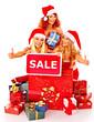 Girl in Santa hat holding Christmas gift box.
