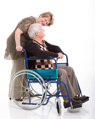 senior woman talking to her disabled husband