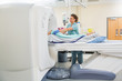 Nurse Preparing Patient For CT Scan Test