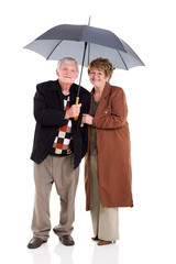 retired couple under a umbrella