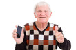 senior man with smart phone giving thumb up