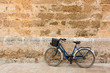 Bicycle in historical Ciutadella stone wall at Balearics