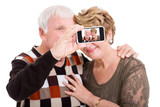 senior couple taking self portrait with smart phone