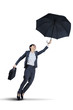 Businesswoman flying with an umbrella