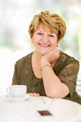 senior woman sitting at home