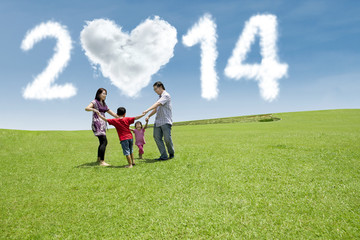 Happy family celebrate new year of 2014