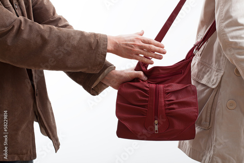 Robber taking a woman purse
