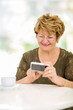 elderly woman reading emails on smart phone