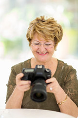 retired woman viewing pictures on camera