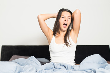 Healthy woman refreshed after a good nights sleep