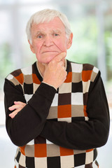 thoughtful elderly man