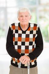 retired senior man with walking cane