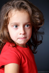 Portrait of crying girl in red