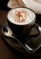 Closeup of fresh Irish coffee with whipped cream.