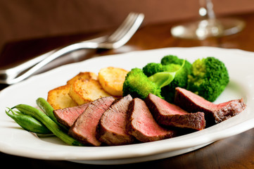 sliced tenderloin steak with vegetables.