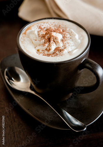 Closeup of fresh Irish coffee with whipped cream.