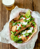 grilled fish tacos on whole grain tortillas with a beer.