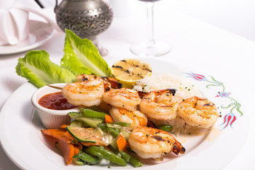 Shrimp Skewers are Grilled and Served with Veggies and Rice