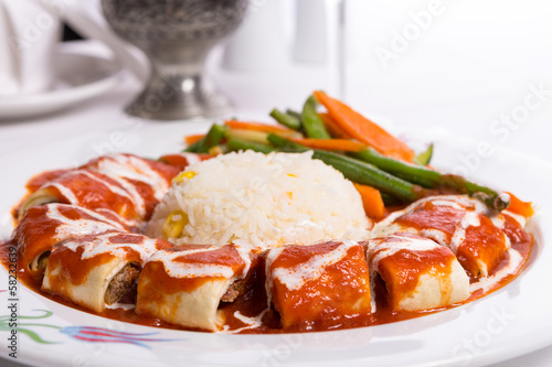 Turkish Beyti Kebap Garnished with Vegetables