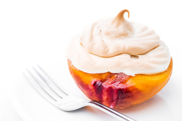 Baked peach with meringue