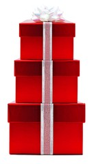 Stack of red Christmas gift boxes with white bow and ribbon