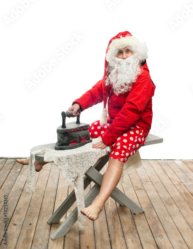 Santa Claus with steam iron