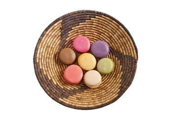 Multicolored macaroons ( French confection) in a plate isolated.