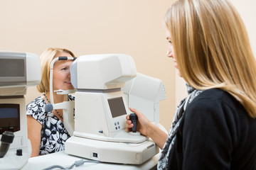 Optometrist Using Tonometer to Measure Patients Eye Pressure