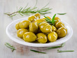 Green olives with herbs.