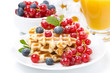 delicious breakfast with waffles, berries and orange juice