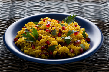 couscous salad with curry, dried cranberries and parsley